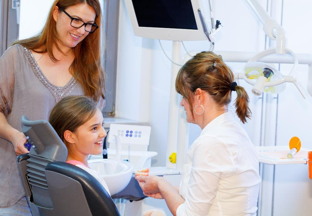 mother & daughter in dentist office l dentist near me goffstown