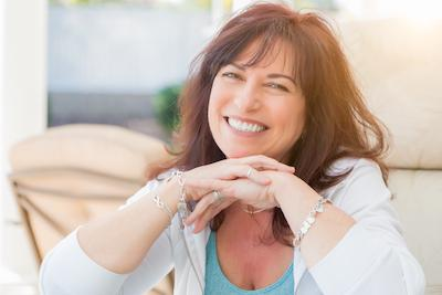 woman with brown hair smiling l dentist 03045